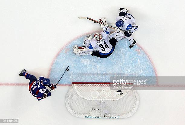 Marian Hossa of Slovakia scores a goal past Miikka Kiprusoff of Finland in the second period during the ice hockey men's bronze medal game between...