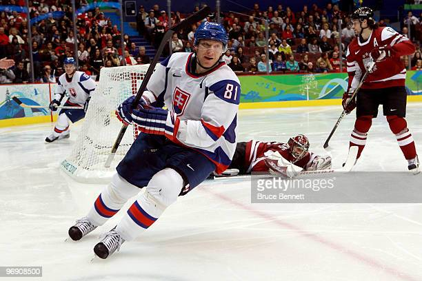 Marian Hossa of Slovakia scores against Edgars Masalskis of Latvia during the ice hockey men's preliminary game between Latvia and Slovakia on day 9...