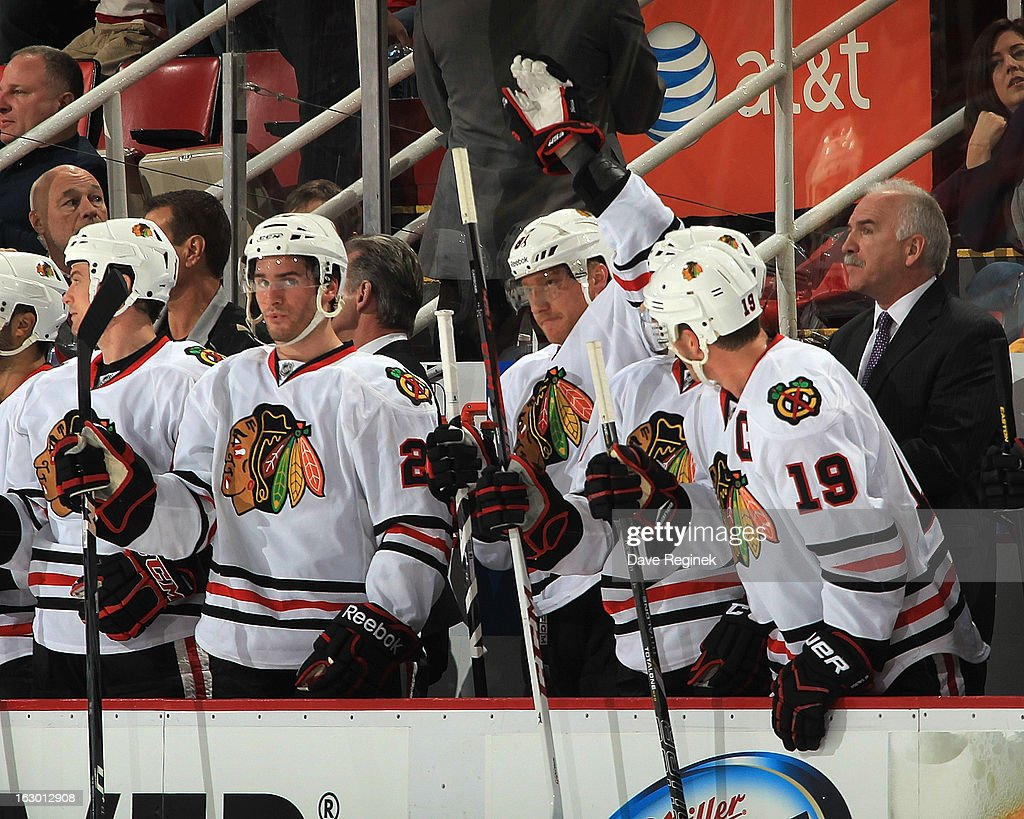 <a gi-track='captionPersonalityLinkClicked' href=/galleries/search?phrase=Marian+Hossa&family=editorial&specificpeople=202233 ng-click='$event.stopPropagation()'>Marian Hossa</a> #81 of the Chicago Blackhawks acknowleges the crowd for his 1,000th NHL game against the Detroit Red Wings at Joe Louis Arena on March 3, 2013 in Detroit, Michigan.