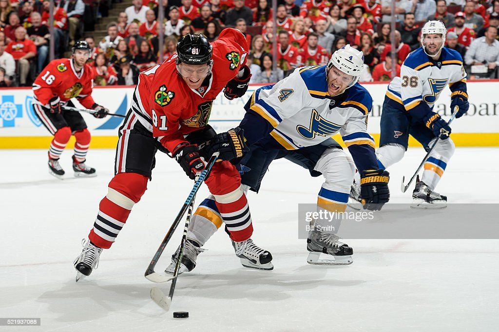 <a gi-track='captionPersonalityLinkClicked' href=/galleries/search?phrase=Marian+Hossa&family=editorial&specificpeople=202233 ng-click='$event.stopPropagation()'>Marian Hossa</a> #81 of the Chicago Blackhawks and <a gi-track='captionPersonalityLinkClicked' href=/galleries/search?phrase=Carl+Gunnarsson&family=editorial&specificpeople=5557315 ng-click='$event.stopPropagation()'>Carl Gunnarsson</a> #4 of the St. Louis Blues chase the puck in the first period of Game Three of the Western Conference Quarterfinals during the 2016 NHL Stanley Cup Playoffs at the United Center on April 17, 2016 in Chicago, Illinois.