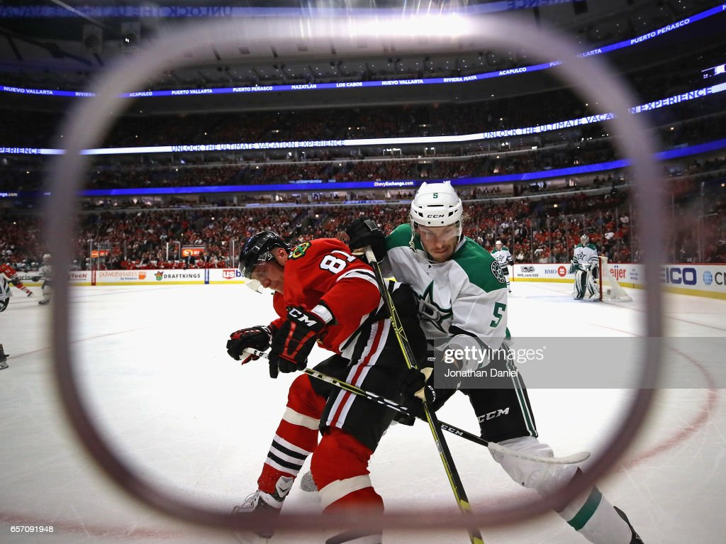 Marian Hossa #81 of the Chicago Blackhawks and Jamie Oleksiak #5 of the Dallas Stars battle for the puck at the United Center on March 23, 2017 in Chicago, Illinois. The Blackhawks defeated the Stars 3-2 in a shootout.