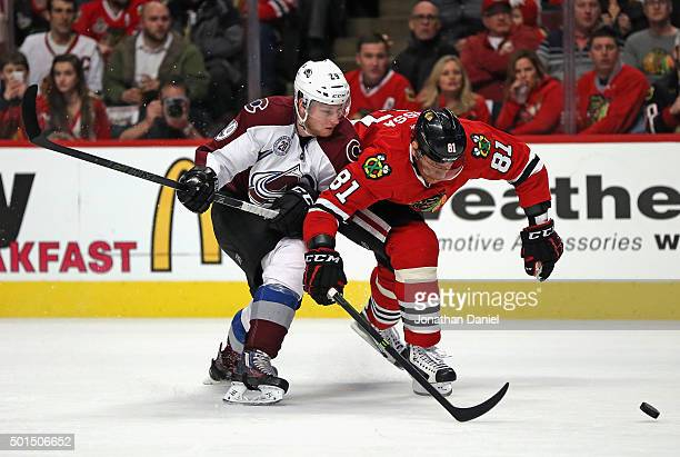 Marian Hossa of the Chicago Blackhawks and Nathan MacKinnon of the Colorado Avalanche chase the puck at the United Center on December 15 2015 in...
