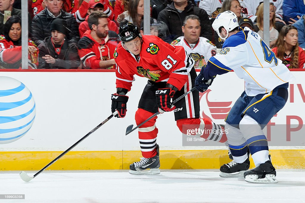 Marian Hossa #81 of the Chicago Blackhawks and Roman Polak #46 of the St. Louis Blues skate up the ice during the NHL game on January 22, 2013 at the United Center in Chicago, Illinois.