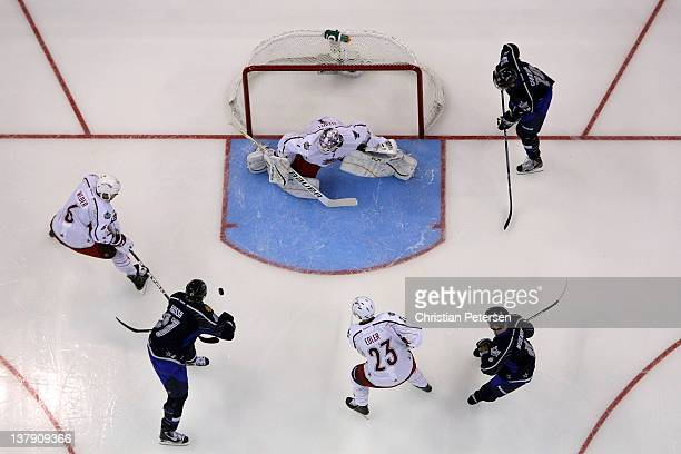Marian Hossa of the Chicago Blackhawks and team Chara attempts a shot on goalie Brian Elliott of the St Louis Blues and team Alfredsson during the...
