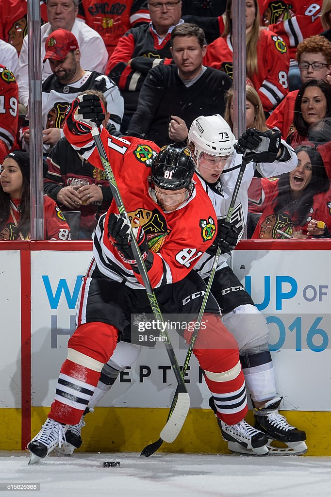 <a gi-track='captionPersonalityLinkClicked' href=/galleries/search?phrase=Marian+Hossa&family=editorial&specificpeople=202233 ng-click='$event.stopPropagation()'>Marian Hossa</a> #81 of the Chicago Blackhawks and <a gi-track='captionPersonalityLinkClicked' href=/galleries/search?phrase=Tyler+Toffoli&family=editorial&specificpeople=6514151 ng-click='$event.stopPropagation()'>Tyler Toffoli</a> #73 of the Los Angeles Kings battle for the puck in the first period of the NHL game at the United Center on March 14, 2016 in Chicago, Illinois.