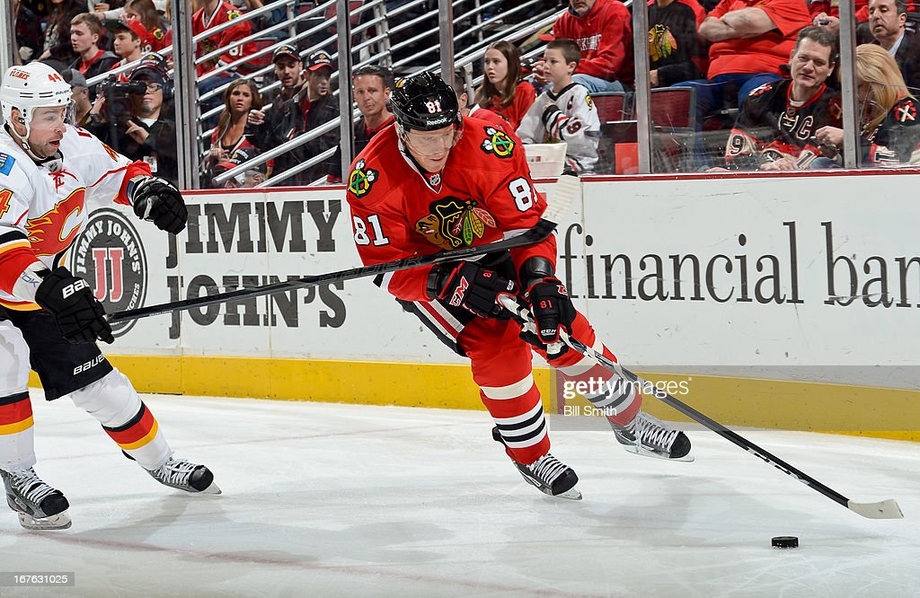 <a gi-track='captionPersonalityLinkClicked' href=/galleries/search?phrase=Marian+Hossa&family=editorial&specificpeople=202233 ng-click='$event.stopPropagation()'>Marian Hossa</a> #81 of the Chicago Blackhawks approaches the puck as Chris Butler #44 of the Calgary Flames skates in from the side during the NHL game on April 26, 2013 at the United Center in Chicago, Illinois.