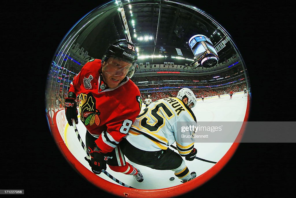 <a gi-track='captionPersonalityLinkClicked' href=/galleries/search?phrase=Marian+Hossa&family=editorial&specificpeople=202233 ng-click='$event.stopPropagation()'>Marian Hossa</a> #81 of the Chicago Blackhawks attempts to get past <a gi-track='captionPersonalityLinkClicked' href=/galleries/search?phrase=Johnny+Boychuk&family=editorial&specificpeople=2125695 ng-click='$event.stopPropagation()'>Johnny Boychuk</a> #55 of the Boston Bruins in Game Five of the 2013 NHL Stanley Cup Final at United Center on June 22, 2013 in Chicago, Illinois. The Chicago Blackhawks defeated the Boston Bruins 3-1.
