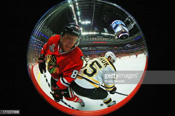 Marian Hossa of the Chicago Blackhawks attempts to get past Johnny Boychuk of the Boston Bruins in Game Five of the 2013 NHL Stanley Cup Final at...