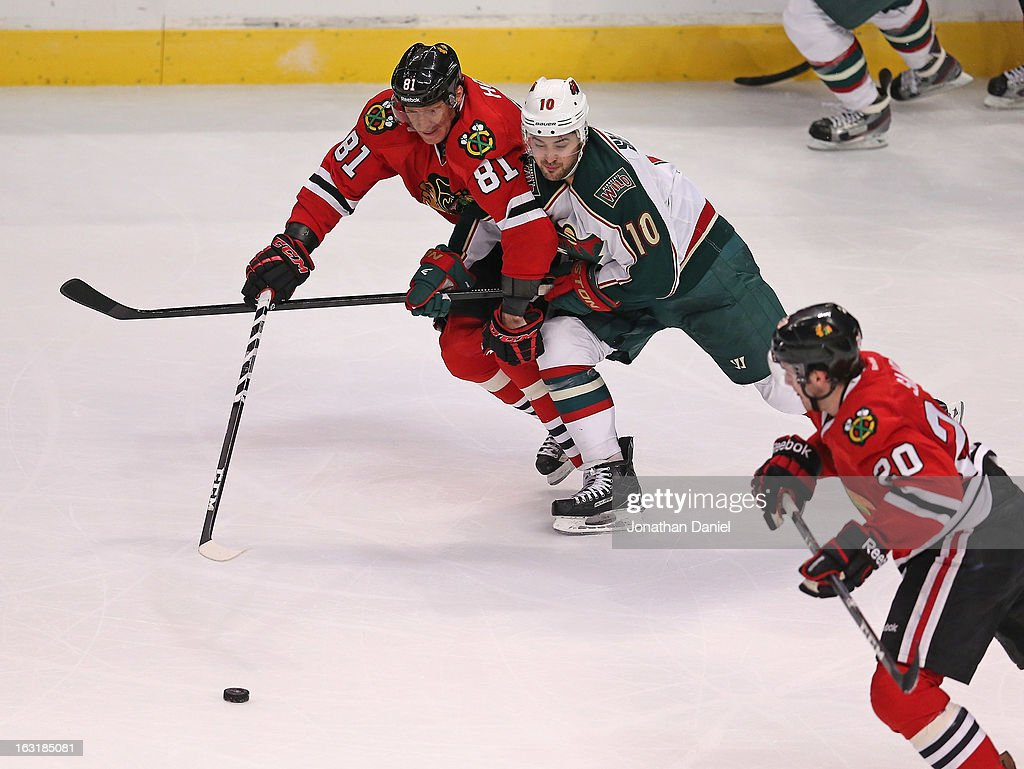 Marian Hossa #81 of the Chicago Blackhawks battles with Devin Setoguchi #10 of the Minnesota Wild for the puck as Brandon Saad #20 also gives chase at the United Center on March 5, 2013 in Chicago, Illinois. The Blackhawks defeated the Wild 5-3.
