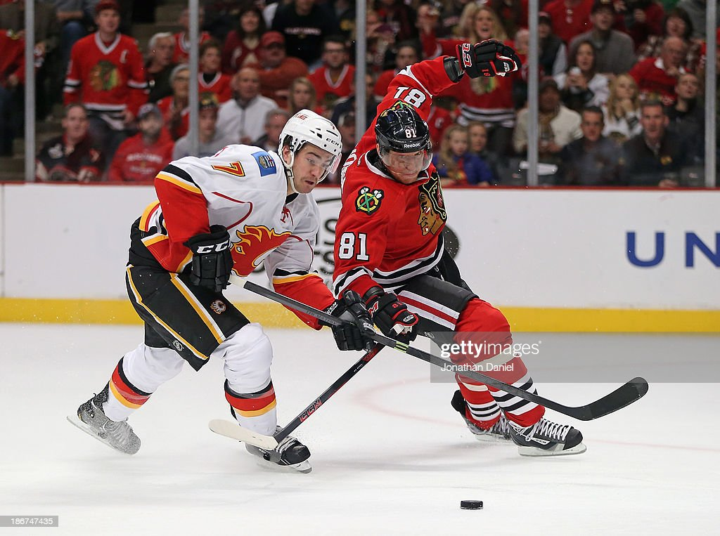 <a gi-track='captionPersonalityLinkClicked' href=/galleries/search?phrase=Marian+Hossa&family=editorial&specificpeople=202233 ng-click='$event.stopPropagation()'>Marian Hossa</a> #81 of the Chicago Blackhawks battles with T.J. Brodie #7 of the Calgary Flames at the United Center on November 3, 2013 in Chicago, Illinois.