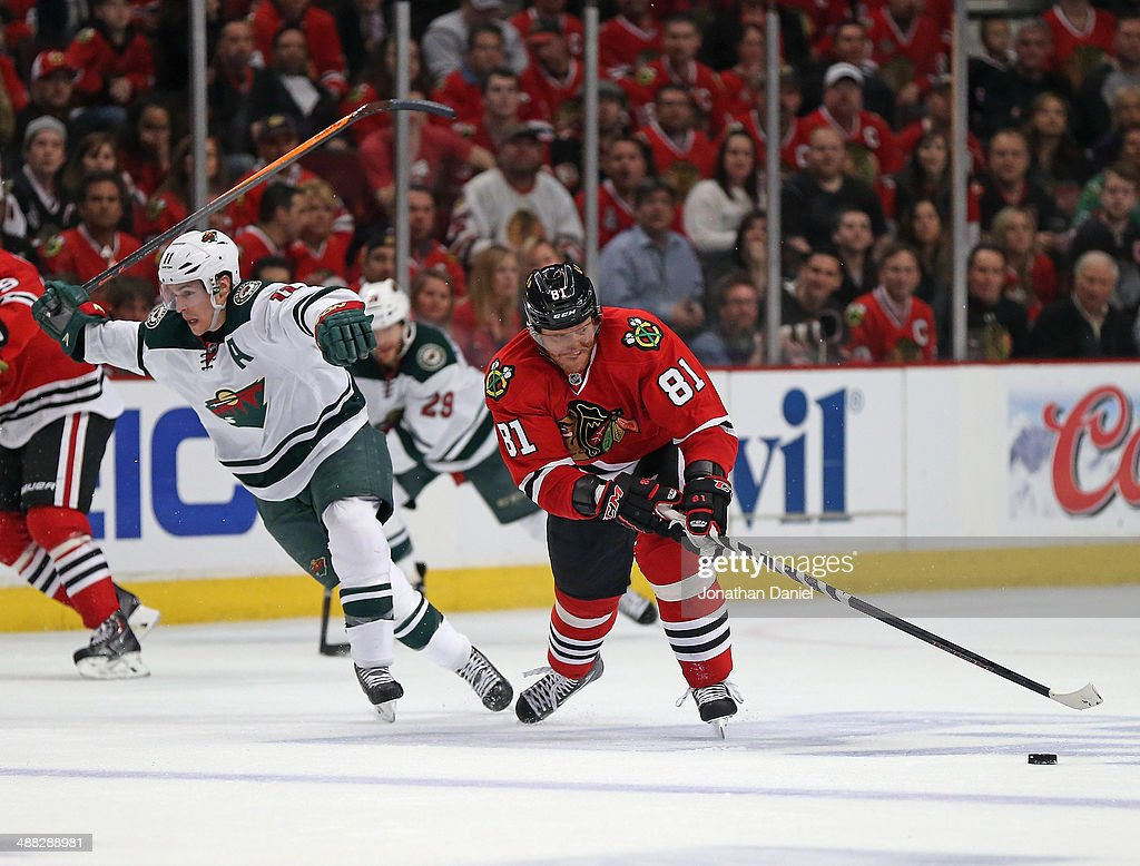 Marian Hossa #81 of the Chicago Blackhawks breaks up the ice past Zach Parise #11 of the Minnesota Wild on his way to a goal assist in the third period in Game Two of the Second Round of the 2014 NHL Stanley Cup Playoffs at the United Center on May 4, 2014 in Chicago, Illinois. The Blackhawks defeated the Wild 4-1.