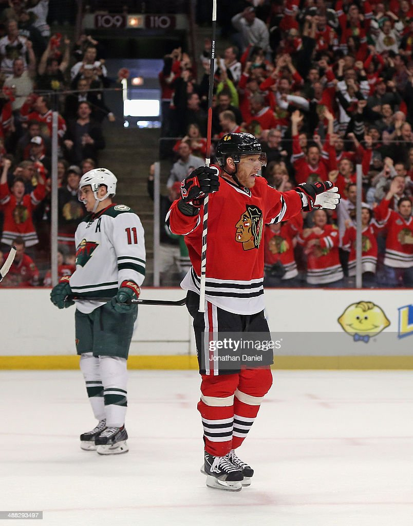 Marian Hossa #81 of the Chicago Blackhawks celebrates a goal past Zach Parise #11 of the Minnesota Wild in Game Two of the Second Round of the 2014 NHL Stanley Cup Playoffs at the United Center on May 4, 2014 in Chicago, Illinois. The Blackhawks defeated the Wild 4-1.