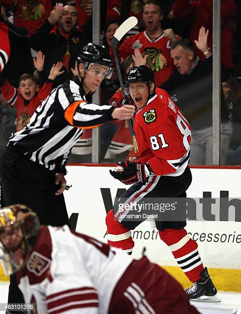 Marian Hossa of the Chicago Blackhawks celebrates his second period goal over Mike Smith of the Arizona Coyotes as referee TJ Luxmore signals the...