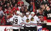Marian Hossa of the Chicago Blackhawks celebrates his second period goal against the Ottawa Senators with teammates Jonathan Toews Patrick Sharp and...