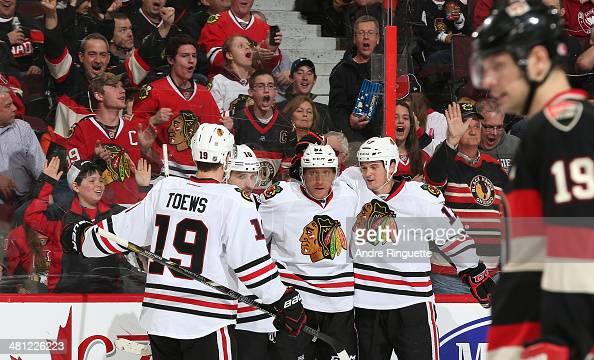 Marian Hossa of the Chicago Blackhawks celebrates his second period goal against the Ottawa Senators with teammates Jonathan Toews Patrick Sharp and...