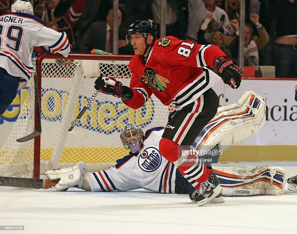 <a gi-track='captionPersonalityLinkClicked' href=/galleries/search?phrase=Marian+Hossa&family=editorial&specificpeople=202233 ng-click='$event.stopPropagation()'>Marian Hossa</a> #81 of the Chicago Blackhawks celebrates scoring the game-winning goal against <a gi-track='captionPersonalityLinkClicked' href=/galleries/search?phrase=Nikolai+Khabibulin&family=editorial&specificpeople=202033 ng-click='$event.stopPropagation()'>Nikolai Khabibulin</a> #35 of the Edmonton Oilers at the United Center on February 25, 2013 in Chicago, Illinois. The Blackhawks defeated the Oilers 3-2 in overtime.