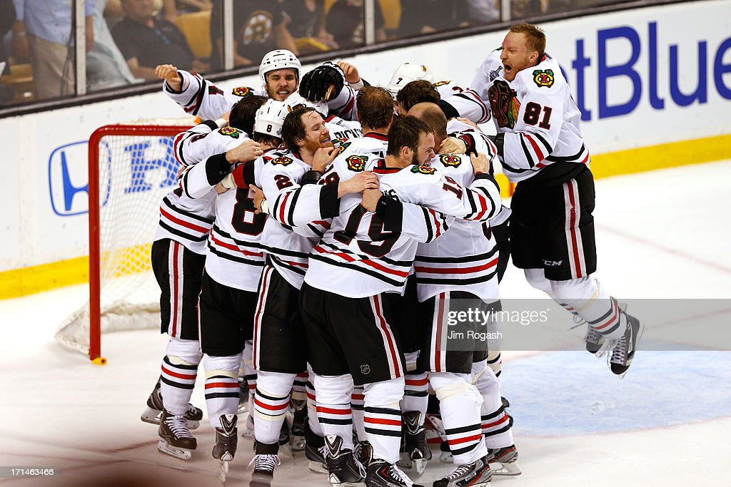 Marian Hossa #81 of the Chicago Blackhawks celebrates with his teammates following their 3-2 win against the Boston Bruins in Game Six of the 2013 NHL Stanley Cup Final at TD Garden on June 24, 2013 in Boston, Massachusetts.