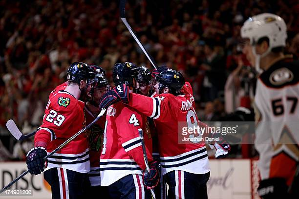 Marian Hossa of the Chicago Blackhawks celebrates with teammates after scoring a second period goal against the Anaheim Ducks in Game Six of the...