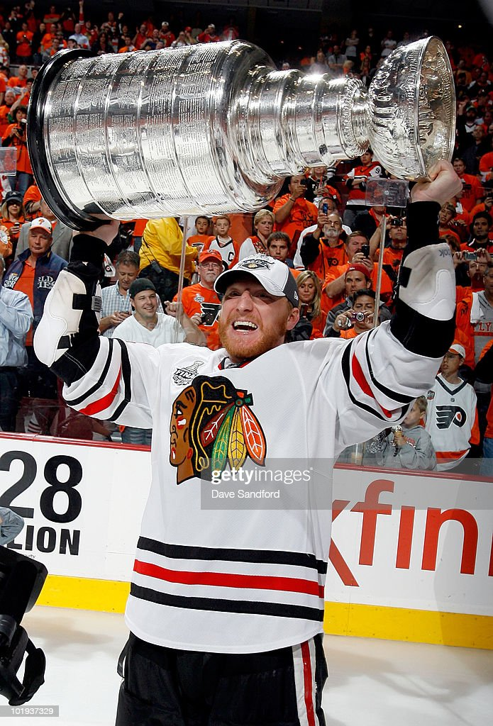 <a gi-track='captionPersonalityLinkClicked' href=/galleries/search?phrase=Marian+Hossa&family=editorial&specificpeople=202233 ng-click='$event.stopPropagation()'>Marian Hossa</a> #81 of the Chicago Blackhawks celebrates with the Stanley Cup after the Blackhawks defeated the Philadelphia Flyers 4-3 in overtime and win the Stanley Cup in Game Six of the 2010 NHL Stanley Cup Final at the Wachovia Center on June 9, 2010 in Philadelphia, Pennsylvania.