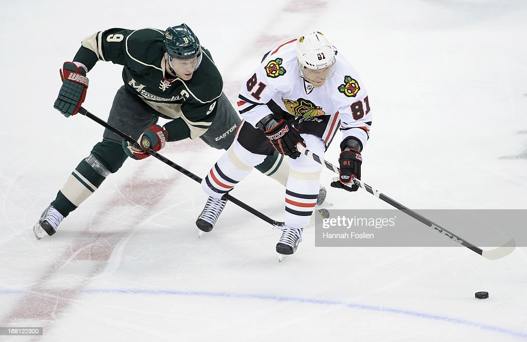 <a gi-track='captionPersonalityLinkClicked' href=/galleries/search?phrase=Marian+Hossa&family=editorial&specificpeople=202233 ng-click='$event.stopPropagation()'>Marian Hossa</a> #81 of the Chicago Blackhawks controls the puck against <a gi-track='captionPersonalityLinkClicked' href=/galleries/search?phrase=Mikko+Koivu&family=editorial&specificpeople=584987 ng-click='$event.stopPropagation()'>Mikko Koivu</a> #9 of the Minnesota Wild during the first period of Game Three of the Western Conference Quarterfinals during the 2013 NHL Stanley Cup Playoffs at Xcel Energy Center on May 5, 2013 in St Paul, Minnesota. The Wild defeated the Blackhawks 3-2 in overtime.