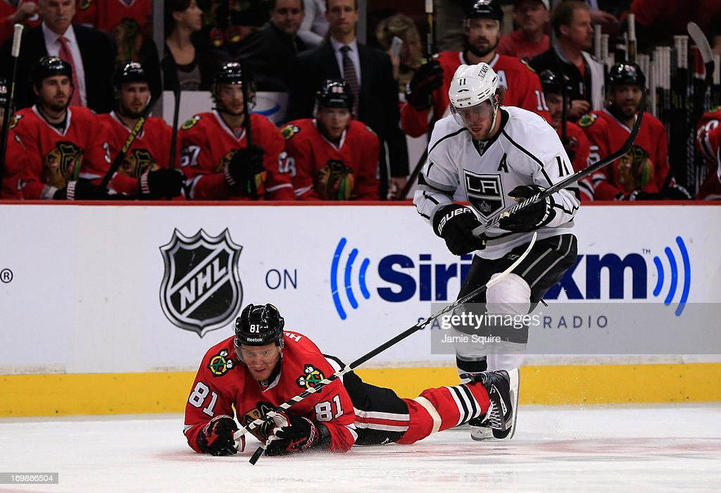 <a gi-track='captionPersonalityLinkClicked' href=/galleries/search?phrase=Marian+Hossa&family=editorial&specificpeople=202233 ng-click='$event.stopPropagation()'>Marian Hossa</a> #81 of the Chicago Blackhawks falls to the ice while playing the puck from <a gi-track='captionPersonalityLinkClicked' href=/galleries/search?phrase=Anze+Kopitar&family=editorial&specificpeople=634911 ng-click='$event.stopPropagation()'>Anze Kopitar</a> #11 of the Los Angeles Kings in the second period of Game Two of the Western Conference Final during the 2013 NHL Stanley Cup Playoffs at United Center on June 2, 2013 in Chicago, Illinois. The Blackhawks defeated the Kings 4-2.