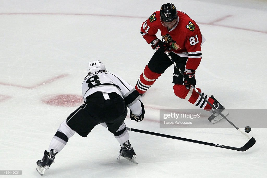 Marian Hossa #81 of the Chicago Blackhawks in action against Drew Doughty #8 of the Los Angeles Kings during Game Seven of the Western Conference Final in the 2014 Stanley Cup Playoffs at United Center on June 1, 2014 in Chicago, Illinois.