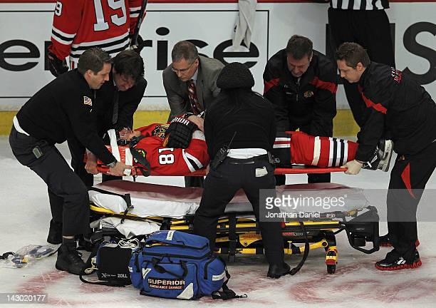 Marian Hossa of the Chicago Blackhawks is placed on a stretcher following a collison against the Phoenix Coyotes in Game Three of the Western...