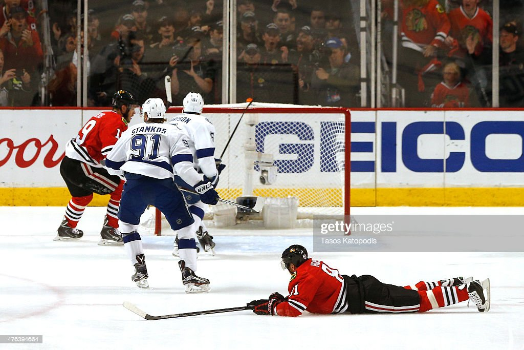 Marian Hossa of the Chicago Blackhawks lays on the ice after falling against the Tampa Bay Lightning during Game Three of the 2015 NHL Stanley Cup...