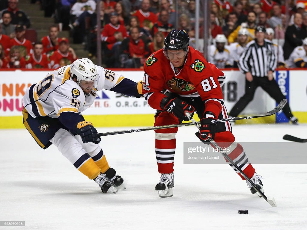 Marian Hossa #81 of the Chicago Blackhawks moves to shoot under pressure from Roman Josi #59 of the Nashville Predators in Game Two of the Western Conference First Round during the 2017 NHL Stanley Cup Playoffs at the United Center on April 15, 2017 in Chicago, Illinois. The Predators defeated the Blackhawks 5-0.
