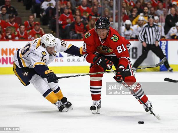 Marian Hossa of the Chicago Blackhawks moves to shoot under pressure from Roman Josi of the Nashville Predators in Game Two of the Western Conference...