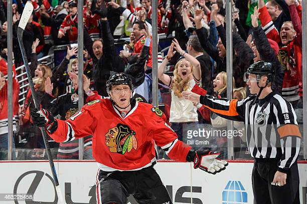 Marian Hossa of the Chicago Blackhawks reacts after scoring against the Vancouver Canucks in the third period to tie the game at the United Center on...
