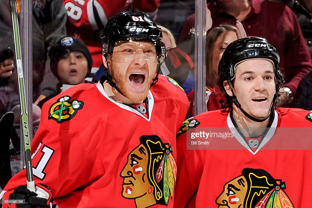 <a gi-track='captionPersonalityLinkClicked' href=/galleries/search?phrase=Marian+Hossa&family=editorial&specificpeople=202233 ng-click='$event.stopPropagation()'>Marian Hossa</a> #81 of the Chicago Blackhawks reacts next to <a gi-track='captionPersonalityLinkClicked' href=/galleries/search?phrase=Andrew+Shaw+-+Jogador+de+h%C3%B3quei+no+gelo&family=editorial&specificpeople=10568695 ng-click='$event.stopPropagation()'>Andrew Shaw</a> #65 after scoring against the Colorado Avalanche in the second period of the NHL game at the United Center on January 10, 2016 in Chicago, Illinois.
