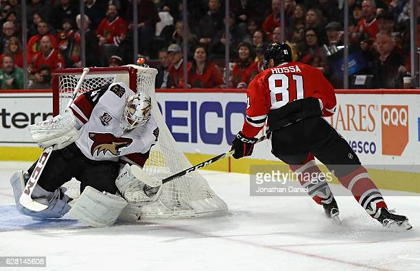 Marian Hossa of the Chicago Blackhawks scores a second period goal against Mike Smith of the Arizona Coyotes at the United Center on December 6 2016...