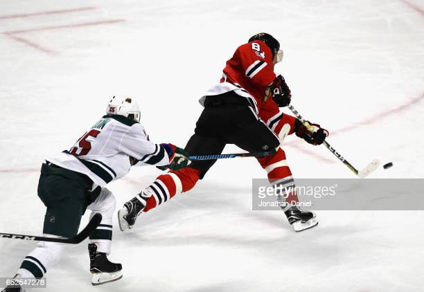 Marian Hossa of the Chicago Blackhawks scores a third period goal in front of Jonas Brodin of the Minnesota Wild at the United Center on March 12...