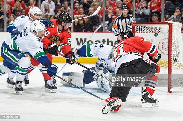 Marian Hossa of the Chicago Blackhawks scores on goalie Eddie Lack of the Vancouver Canucks in the third period during the NHL game at the United...