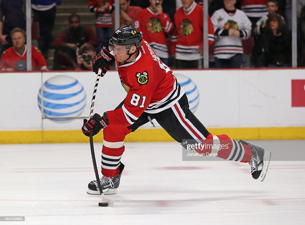 <a gi-track='captionPersonalityLinkClicked' href=/galleries/search?phrase=Marian+Hossa&family=editorial&specificpeople=202233 ng-click='$event.stopPropagation()'>Marian Hossa</a> #81 of the Chicago Blackhawks scores the game-winning goal in the shooutout against the Minnesota Wild at the United Center on April 3, 2014 in Chicago, Illinois. The Blackhawks defeated the Wild 3-2 in a shootout.