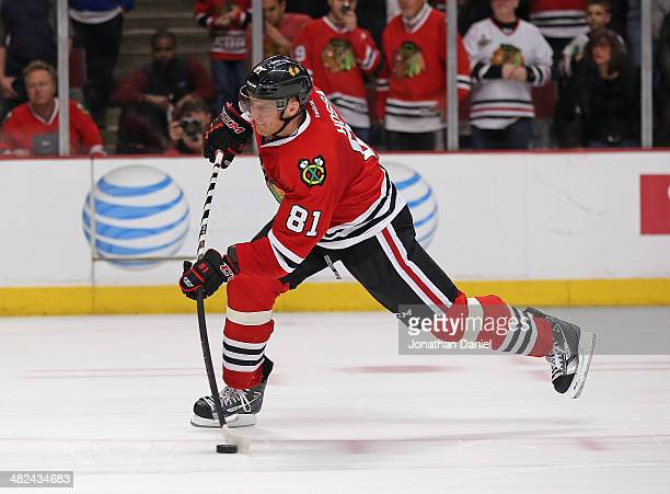 Marian Hossa of the Chicago Blackhawks scores the gamewinning goal in the shooutout against the Minnesota Wild at the United Center on April 3 2014...