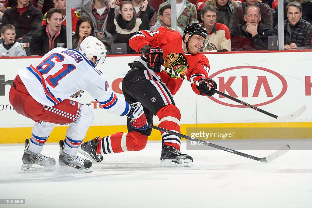 <a gi-track='captionPersonalityLinkClicked' href=/galleries/search?phrase=Marian+Hossa&family=editorial&specificpeople=202233 ng-click='$event.stopPropagation()'>Marian Hossa</a> #81 of the Chicago Blackhawks shoots against <a gi-track='captionPersonalityLinkClicked' href=/galleries/search?phrase=Rick+Nash&family=editorial&specificpeople=202196 ng-click='$event.stopPropagation()'>Rick Nash</a> #61 of the New York Rangers during the NHL game on January 08, 2014 at the United Center in Chicago, Illinois.