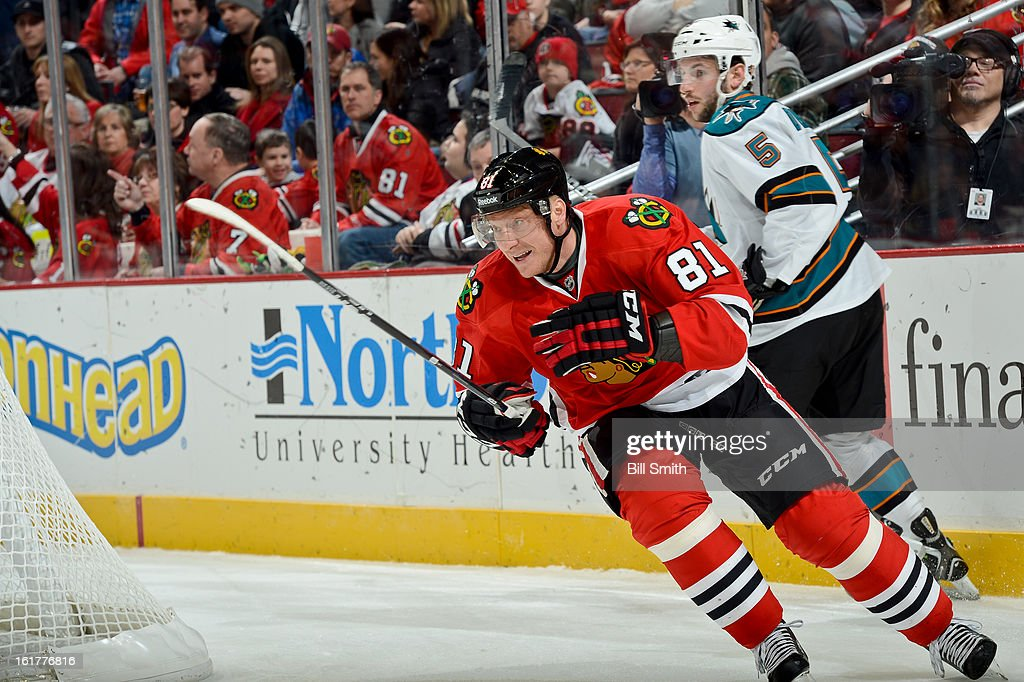 <a gi-track='captionPersonalityLinkClicked' href=/galleries/search?phrase=Marian+Hossa&family=editorial&specificpeople=202233 ng-click='$event.stopPropagation()'>Marian Hossa</a> #81 of the Chicago Blackhawks skates across the ice while <a gi-track='captionPersonalityLinkClicked' href=/galleries/search?phrase=Jason+Demers&family=editorial&specificpeople=2282534 ng-click='$event.stopPropagation()'>Jason Demers</a> #5 of the San Jose Sharks stands behind during the NHL game on February 15, 2013 at the United Center in Chicago, Illinois.