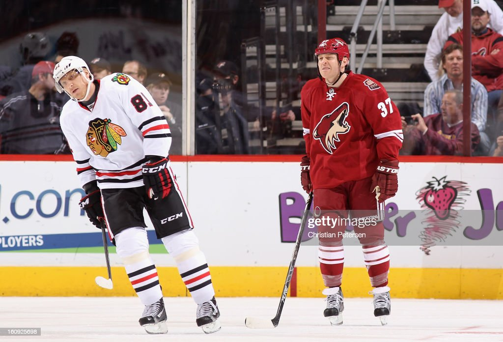 <a gi-track='captionPersonalityLinkClicked' href=/galleries/search?phrase=Marian+Hossa&family=editorial&specificpeople=202233 ng-click='$event.stopPropagation()'>Marian Hossa</a> #81 of the Chicago Blackhawks skates alongside <a gi-track='captionPersonalityLinkClicked' href=/galleries/search?phrase=Raffi+Torres&family=editorial&specificpeople=204612 ng-click='$event.stopPropagation()'>Raffi Torres</a> #37 of the Phoenix Coyotes during the NHL game at Jobing.com Arena on February 7, 2013 in Glendale, Arizona. The Blackhawks defeated the Coyotes 6-2.