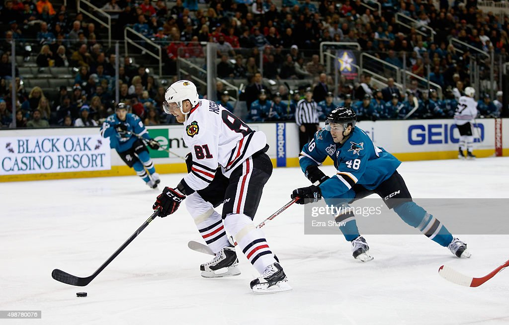 Marian Hossa #81 of the Chicago Blackhawks skates past Tomas Hertl #48 of the San Jose Sharks at SAP Center on November 25, 2015 in San Jose, California.