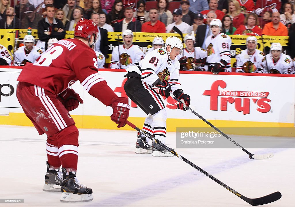 <a gi-track='captionPersonalityLinkClicked' href=/galleries/search?phrase=Marian+Hossa&family=editorial&specificpeople=202233 ng-click='$event.stopPropagation()'>Marian Hossa</a> #81 of the Chicago Blackhawks skates with the puck past <a gi-track='captionPersonalityLinkClicked' href=/galleries/search?phrase=Lauri+Korpikoski&family=editorial&specificpeople=2108074 ng-click='$event.stopPropagation()'>Lauri Korpikoski</a> #28 of the Phoenix Coyotes during the NHL game at Jobing.com Arena on January 20, 2013 in Glendale, Arizona. The Blackhawks defeated the Coyotes 6-4.