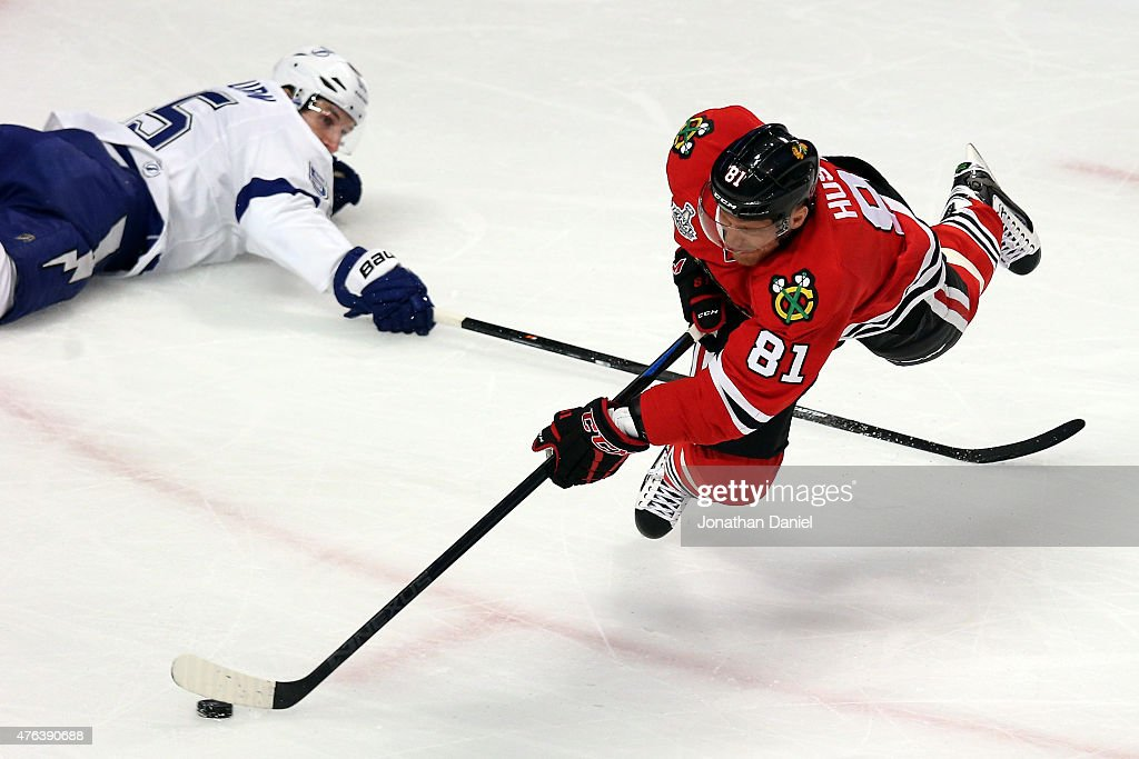 <a gi-track='captionPersonalityLinkClicked' href=/galleries/search?phrase=Marian+Hossa&family=editorial&specificpeople=202233 ng-click='$event.stopPropagation()'>Marian Hossa</a> #81 of the Chicago Blackhawks takes a shot as he is tripped by <a gi-track='captionPersonalityLinkClicked' href=/galleries/search?phrase=Braydon+Coburn&family=editorial&specificpeople=2077063 ng-click='$event.stopPropagation()'>Braydon Coburn</a> #55 of the Tampa Bay Lightning in the first period during Game Three of the 2015 NHL Stanley Cup Final at the United Center on June 8, 2015 in Chicago, Illinois.