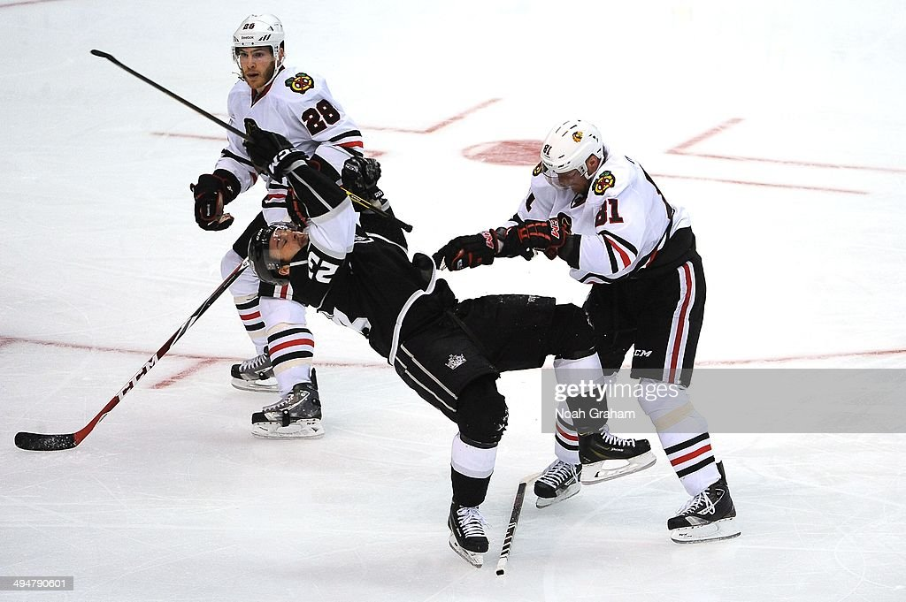 <a gi-track='captionPersonalityLinkClicked' href=/galleries/search?phrase=Marian+Hossa&family=editorial&specificpeople=202233 ng-click='$event.stopPropagation()'>Marian Hossa</a> #81 of the Chicago Blackhawks throws the check against Dustin Brown #23 of the Los Angeles Kings in Game Six of the Western Conference Final during the 2014 Stanley Cup Playoffs at Staples Center on May 30, 2014 in Los Angeles, California.
