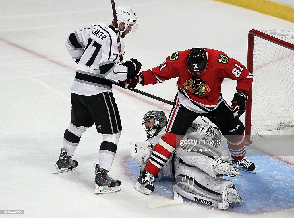 Marian Hossa #81 of the Chicago Blackhawks trips over Jonathan Quick #32 of the Los Angeles Kings during Game Seven of the Western Conference Final in the 2014 Stanley Cup Playoffs at United Center on June 1, 2014 in Chicago, Illinois.