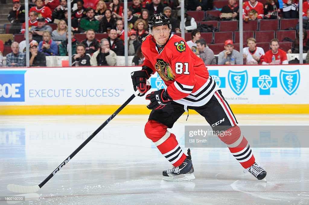 Marian Hossa #81 of the Chicago Blackhawks watches for the puck during the NHL game against the Detroit Red Wings on January 27, 2013 at the United Center in Chicago, Illinois.