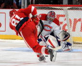 Marian Hossa of the Detroit Red Wings breaks his stick in a overtime shoot attempt on Cedrick Desjardins of the during NHL preseason opener on...