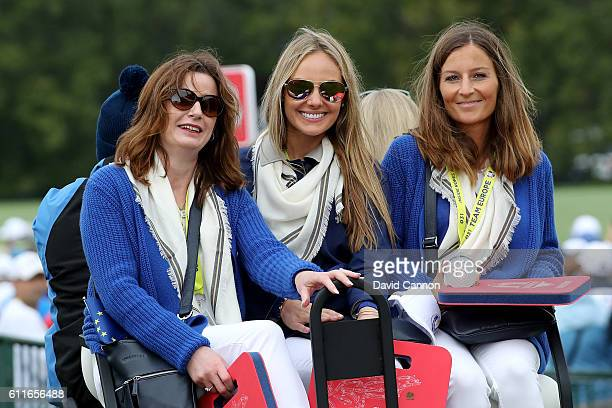 Marian Lawrie Erica Stoll and Bethany Wood ride a cart during morning foursome matches of the 2016 Ryder Cup at Hazeltine National Golf Club on...
