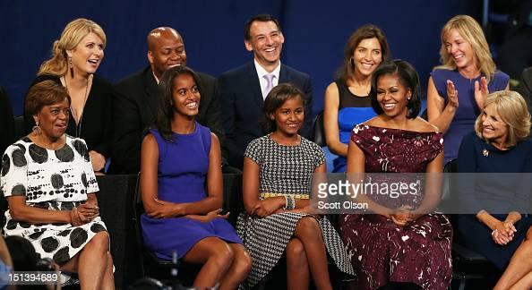 Marian Robinson Malia Obama Sasha Obama First lady Michelle Obama and Second lady Dr Jill Biden watch as Democratic presidential candidate US...