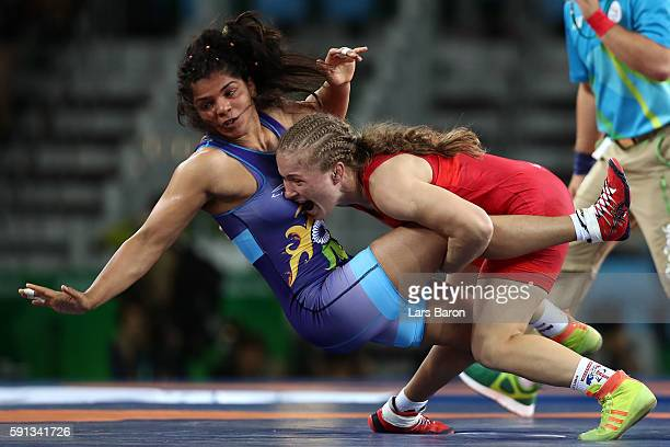 Mariana Cherdivara Esanu of Moldova competes against Sakshi Malik of India during a Women's Freestyle 58kg 1/8 Final bout on Day 12 of the Rio 2016...